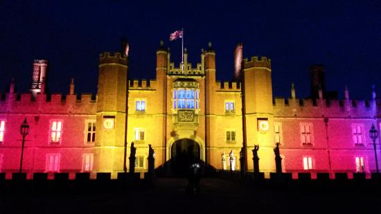 Hampton Court Palace Christmas Party KT8, lit up building, British flags