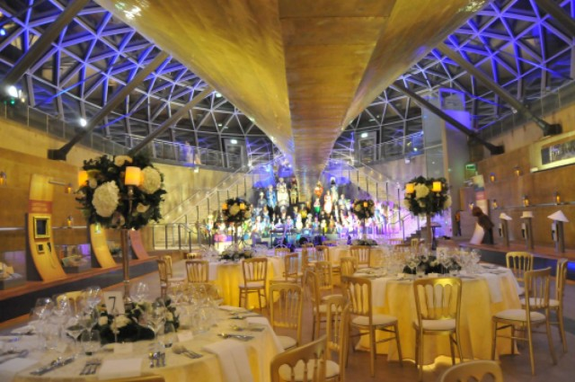 Cutty Sark Christmas Venue Hire SE10. seated dinner, flower centre pieces