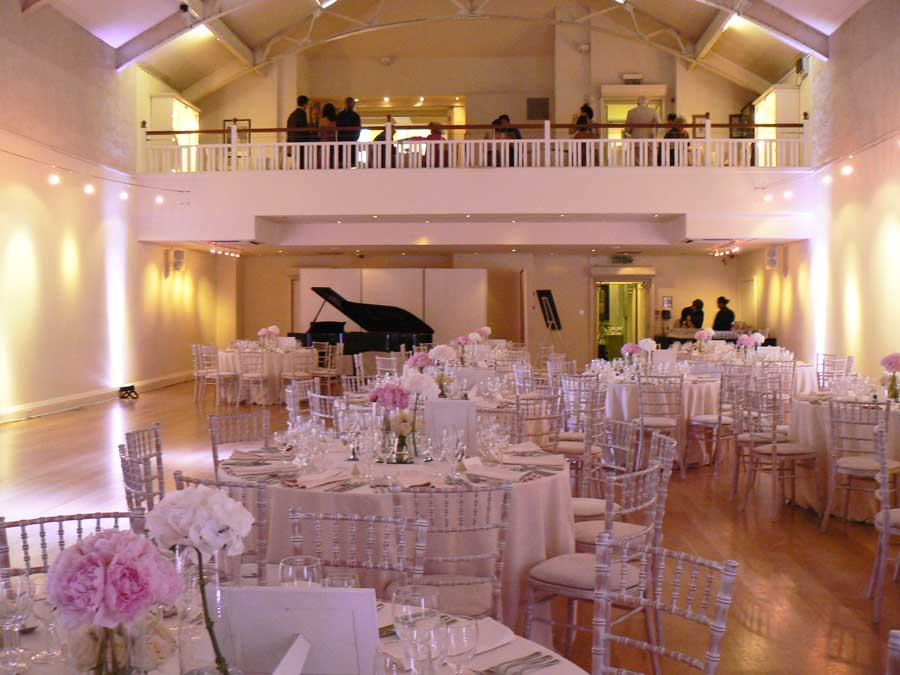 Hellenic Centre London Venue Hire W1, large sit down dinner with pink flowers