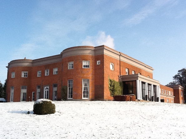 Highfield Park Christmas Party RG2, red brick building in the snow