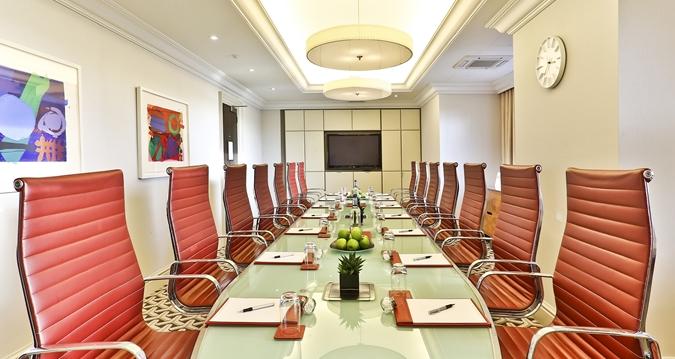 Hilton London Park Lane Venue Hire W1, boardroom set up with orange chairs
