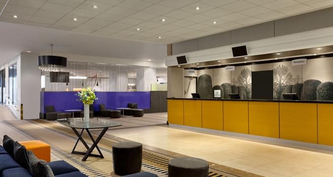 Hilton London Kensington Venue Hire W1, reception with yellow panneling
