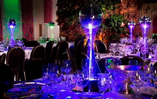 Dinning tables light in purple with stunning candle centre peaces Kensington Roof Gardens Christmas Party W8