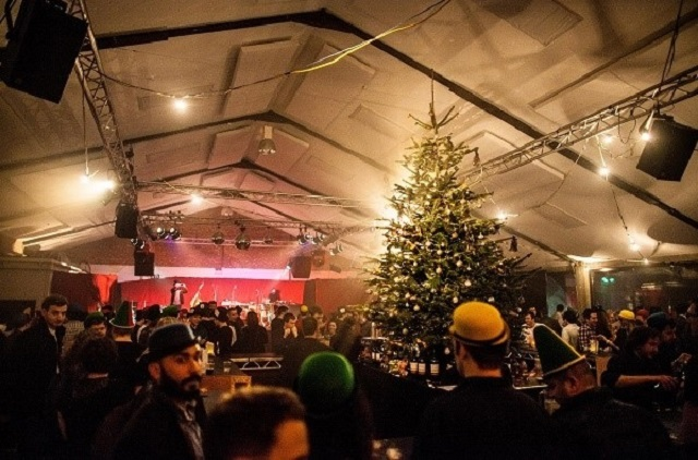 Kia Oval Shared Christmas Party SE11. Standing reception with large christmas tree decorated for a festive feel.