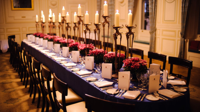 King Herald in boardroom style dressed for a dinner with tall candles and place settings In and Out Club Venue Hire SW1