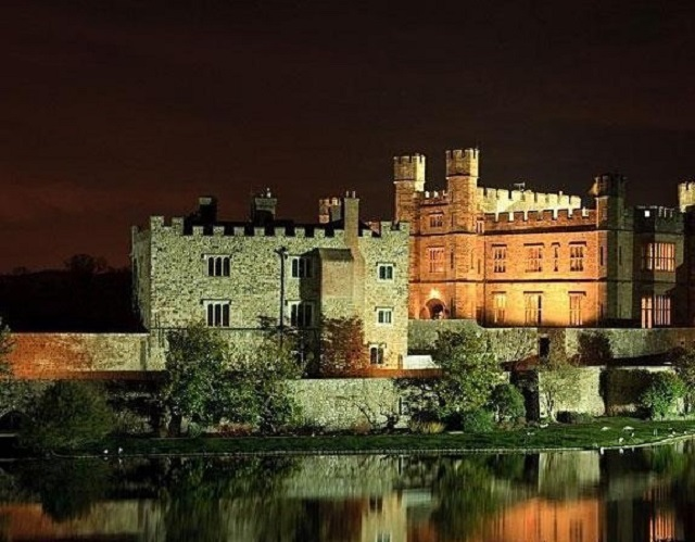 Leeds Castle Christmas Party ME17. extertior of historic building in evening.