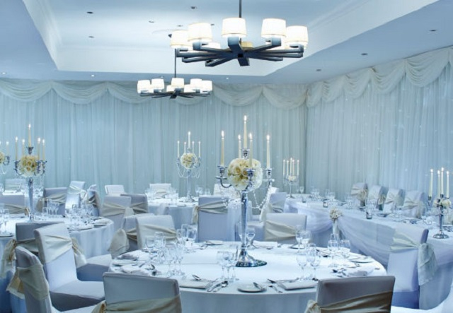 Marriott Hotel City Centre Christmas Party L11. Round tables set up with chairs/chair covers.