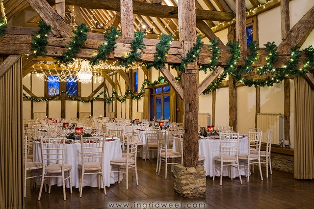 Loseley Guildford Park Christmas party GU3. Barn set out with round tables and decorated with a festive feel.