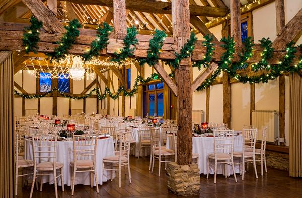 Loseley Park Christmas Party GU3, barn with tinsel on beams