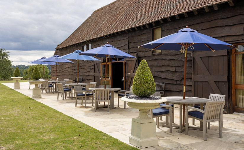 Loseley Park Summer Party GU3, terrace with umbrellas and furniture