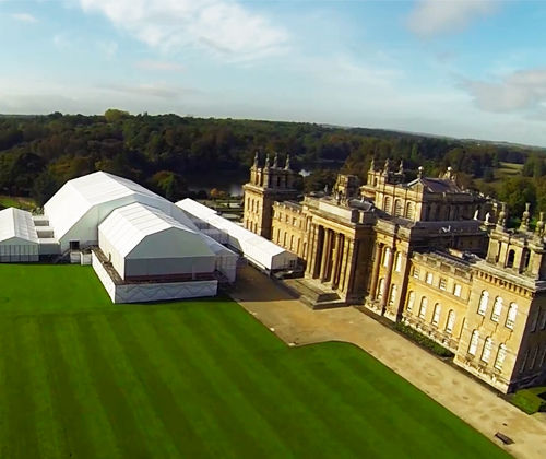 Exterior photo of palace with marquee attached.Blenheim Palace Venue Hire OX20