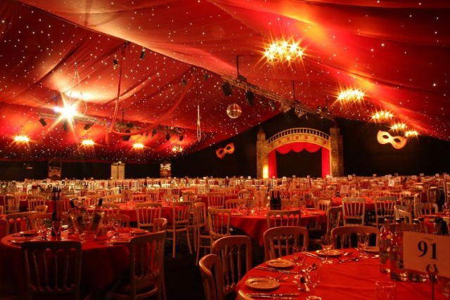 Aldenham Park Masquerade Ball Christmas Party WD6, stunning theming, round tables set for dinner, draping