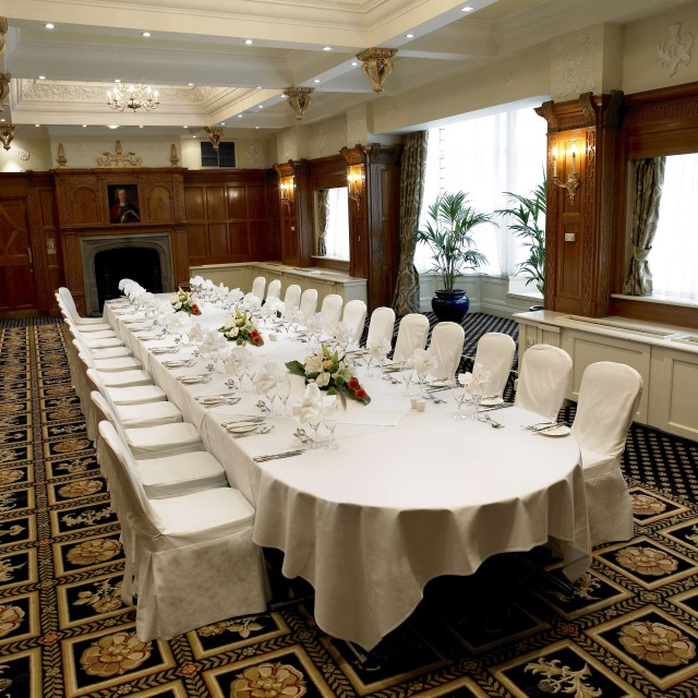 Banquet layout dressed in white linen in the Lancaster Suite Midland Hotel Venue Hire M60