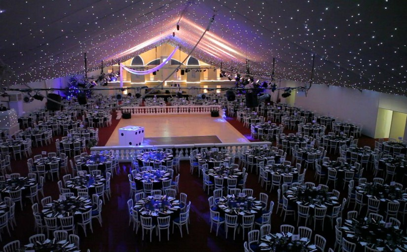 Syon Park Christmas Party TW8, large seated dinner area, dance floor in the centre, round tables, ceiling lighting