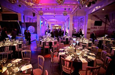 Madame Tussauds Shared Christmas Party NW1, dinner set up on round tables with festive decorations and a standing drinks reception area