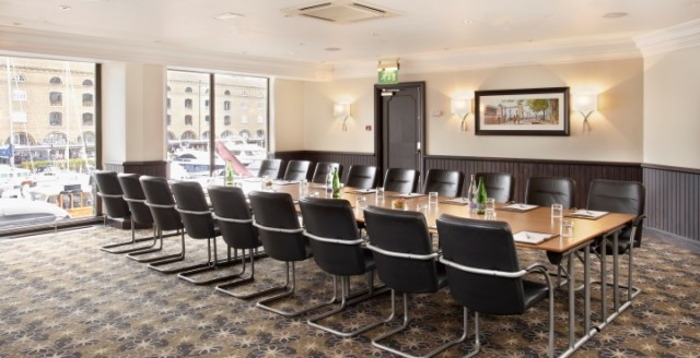 Neville Room set up in boardroom style for a meeting with floor to ceiling windows Bridge Suites Tower Hotel Venue Hire E1