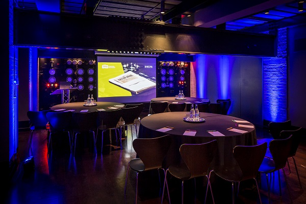 Churchill War Rooms Venue Hire SW1. Inside of venue with conference set up and projector screen in front