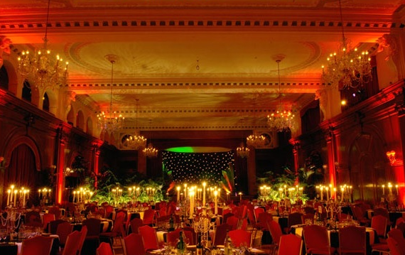 Porchester Hall Christmas Party W2, seated dinner set up, high ceilings, large chandeliers, table centre pieces