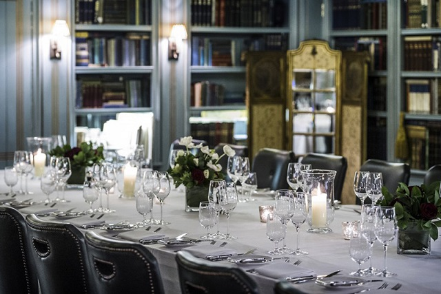 Bentley's Bar Grill Venue Hire W1. Dining room, set up for dinner. modern, fresh feel. with long table with flower centre pieces.
