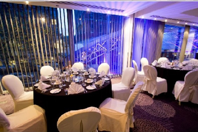 Dining area decorated for christmas. Radisson Blu Portman Christmas Party W1