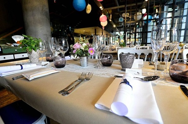 Refinery Bankside Christmas Party SE1. Table set out for guests to enjoy their Christmas party. Table set out with cutlery