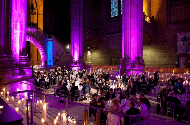 Royal Liver Building Venue Hire L3, stunning uplighters to create an atmosphere, seated dinner on round tables, large collumns