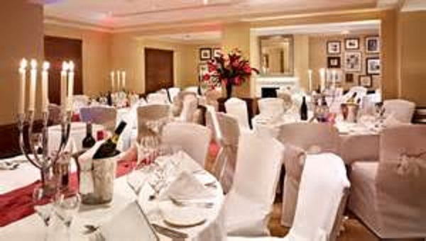 Park Plaza Sherlock Holmes Christmas Party W1. Christmas dining with round tables and table decorations.