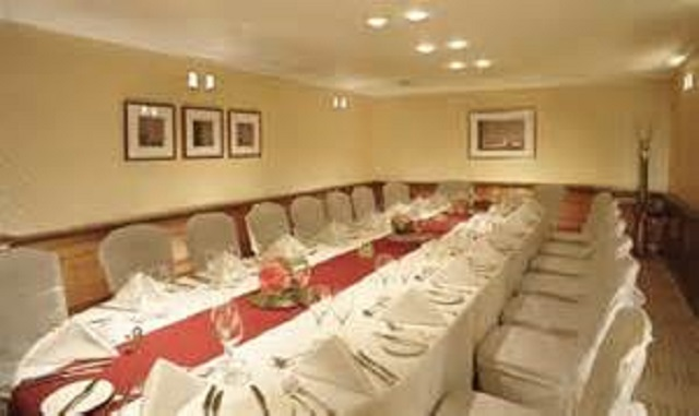 Park Plaza Sherlock Holmes Christmas Party W1. Private dining room table, decorated for Christmas.
