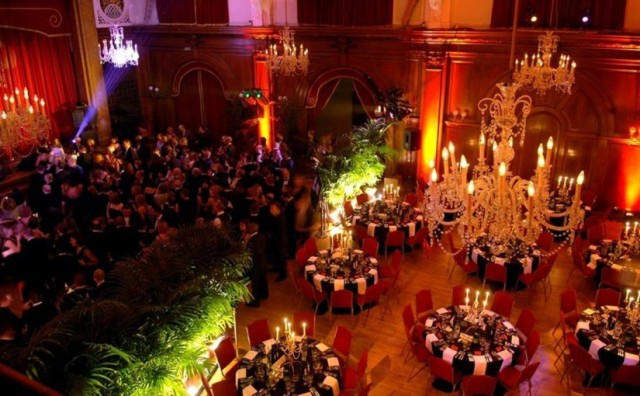 Porchester Hall Christmas Party W2, large chandeliers, up lighters on the columns,