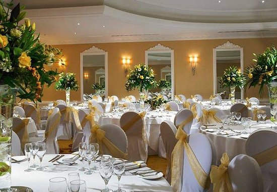 St Pierre Marriott Hotel Venue Hire NP16, wedding room set up, stunning centre pieces, chair covers