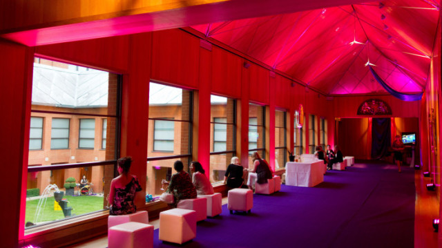 Haberdashers Hall Summer Party EC1. Pink mood lighting cushion sofas, drinks reception.