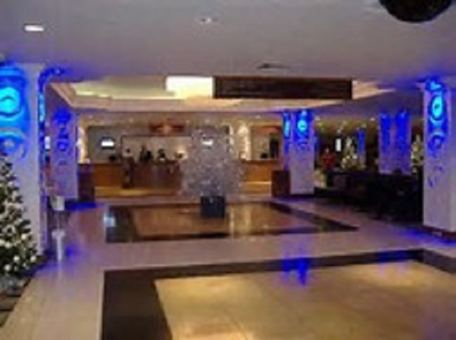 Renaissance Heathrow Hotel Christmas Party TW6. Recpetion lobby at hotel. with blue lighting giving hotel a festice feel.