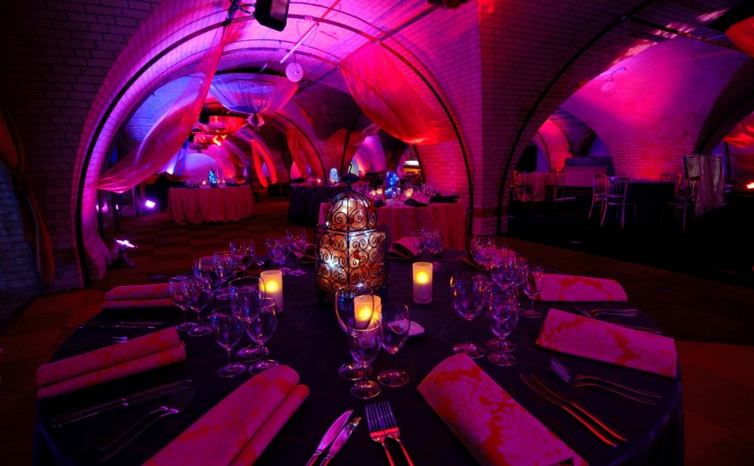 Old Billingsgate Vaults Christmas Party EC3, seated dinner set up, ambience lighting, archways