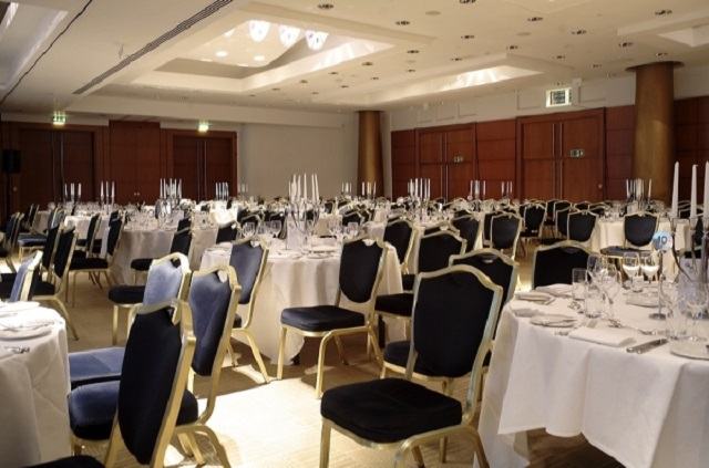 Park Plaza Victoria Christmas Party SW1. Dining room tables set out for christmas dinner.