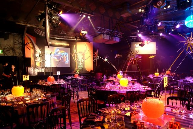 Hall decorated, festive feel. with tables set up for seated dining. Ministry Of Sound Christmas Party SE1