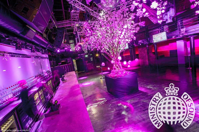 Festive feel. Christmas Tree set up in centre of main bar. with festive lighting. Ministry Of Sound Christmas Party SE1