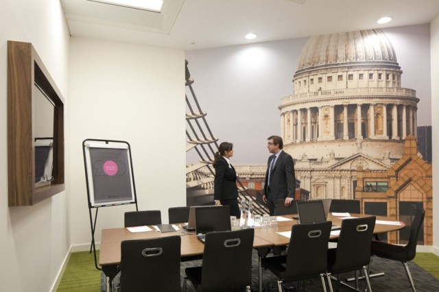 Smaller meeting room set in boardroom style for a meeting with large poster of st. pauls cathedral in the background 200 Aldersgate Venue Hire EC1