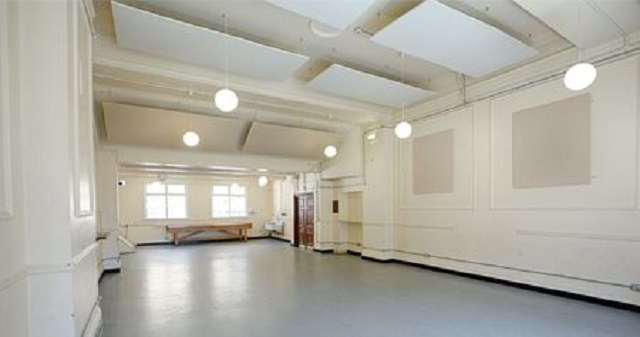 Shoreditch Town Hall Venue Hire EC1. large event space with abundance of daylight coming through large windows.