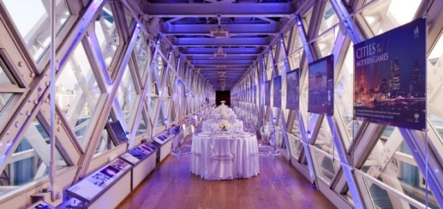 Tower Bridge Walkways Venue Hire London SE1. As the sun sets and the London skylight is illuminated with city lights, the Walkways become a magical setting for elegant dining, receptions and private celebrations
