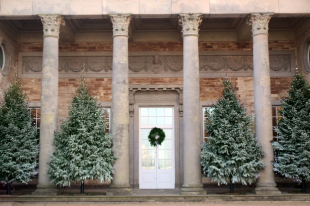Exterior view with large christmas trees in between pillar architecture Compton Verney Christmas Party CV35