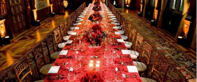 Two Temple Place Christmas Party WC2, seated dinner set up, stunning red colour sheme, festive colours