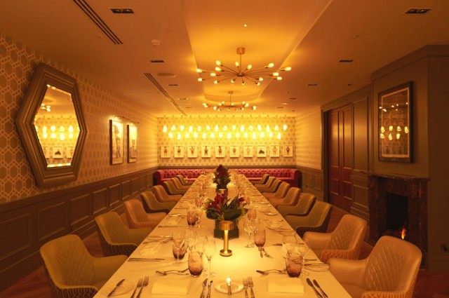 Drawing Room set out of a private diner with smart leather chairs and dimmed lighting on one long table 8 Fenchurch Place Venue Hire EC3