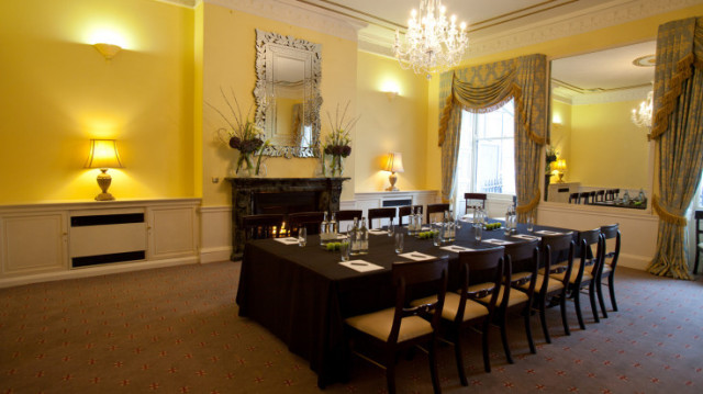 Adam Room set for a private meeting in boardroom style with lots of natural daylight and an open fireplace 28 Portland Place Venue Hire W1