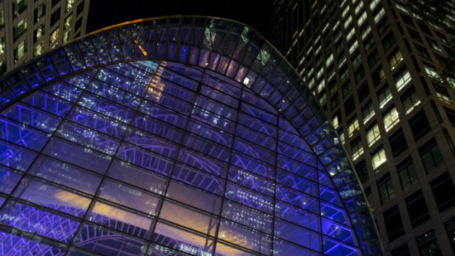 Exterior View of the venue with blue uplighters on the glass building East Wintergarden Christmas Party E14