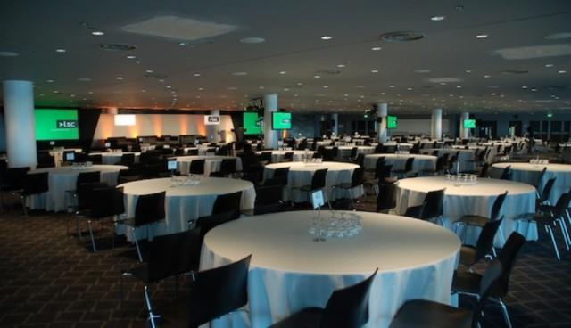 Atrium set for a large conference with round tables set in cabaret style with large screens at the front of the room Wembley Stadium Venue Hire HA9