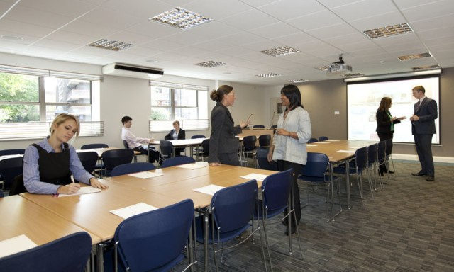 Meeting Room in classroom style with delegates interacting with natural daylight Avonmouth House Venue Hire SE1