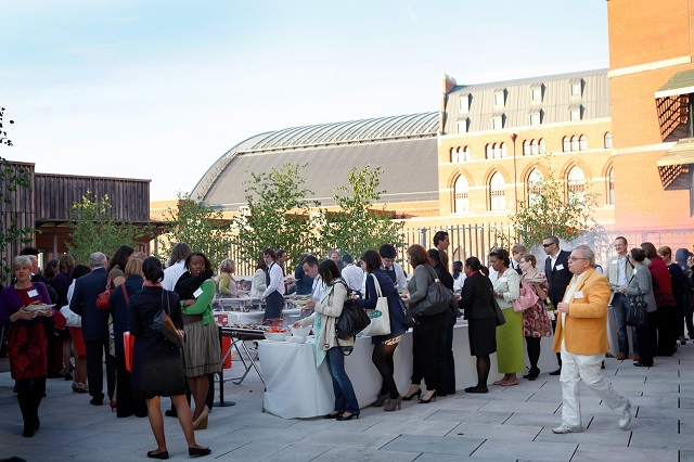British Library Summer Party NW1. Outside barbaque event going on.