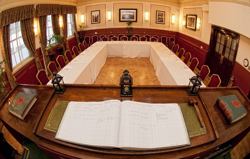 Barrister Court Rooms with view from the original court room book and banqueting tables set out for a formal meeting Browns Covent Garden Venue Hire WC2