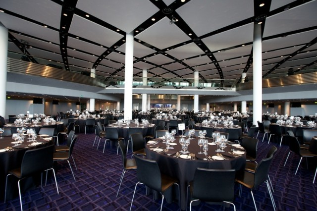 Bobby Moore Room set for a dinner party with high ceilings and round tables set for dinner Wembley Stadium Christmas Party HA9