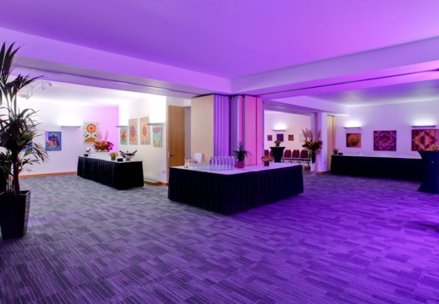 Whittington Suite set for a drinks reception with large tables dressed in white and black linen with wall partitions open Cavendish Conference Centre Venue Hire W1